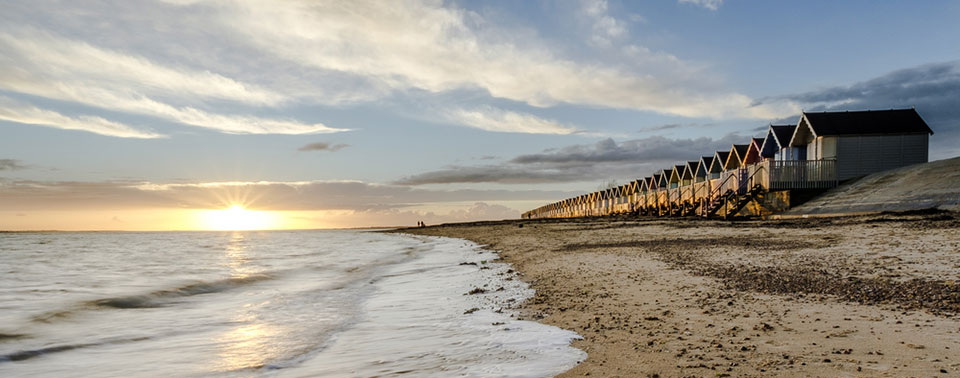 Beach huts at West Mersea at sunset